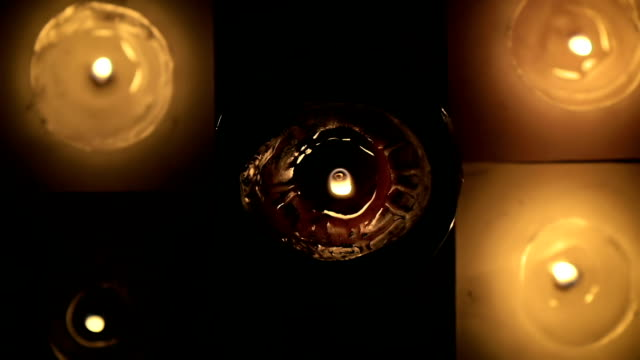 Abstract-a-lot-of-beautiful-wax-candles-burning-view-from-the-top-in-slow-motion-
