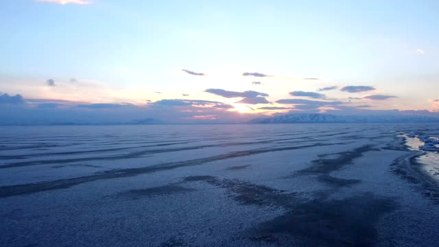 Flying-over-iced-sea-or-ocean-by-helicopter-