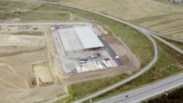 Aerial-footage-of-building-new-large-warehouse