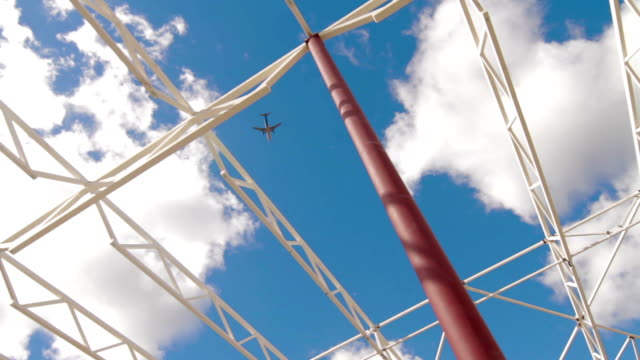 Building-new-large-warehouse-complex-Airplane-in-blue-sky