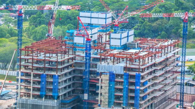 4K-Time-lapse-Construction-crane-in-Singapore-city