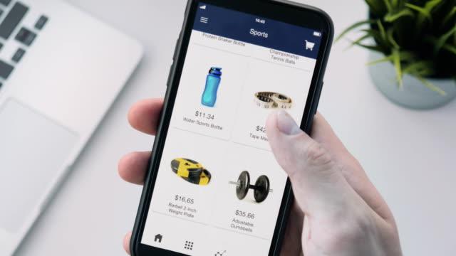 Shopping-online-using-smartphone-app-and-choosing-sport-equipment