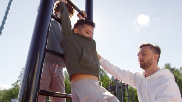 Mother-and-Dad-Supporting-Son-during-Outdoor-Workout
