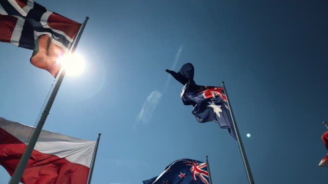 National-flags-flying-united-in-slow-motion-with-natural-sun-flare