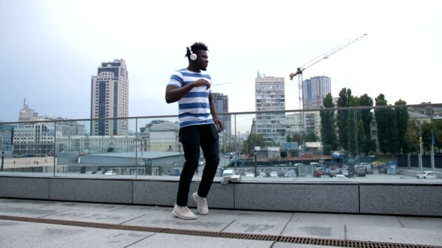 Trendy-african-american-man-dancing-outdoors