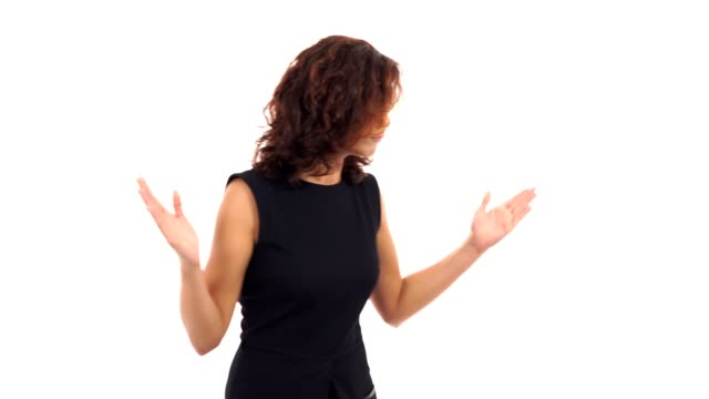 Displeased-upset-young-woman-waving-her-arms-in-a-mad-gesture-and-looking-in-the-camera-isolated-on-white-background