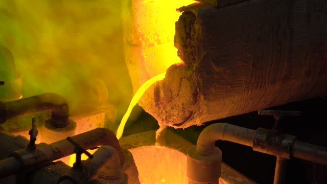 Metallurgical-production-The-molten-metal-is-pouring-from-the-furnace-the-hot-liquid-is-very-dangerous