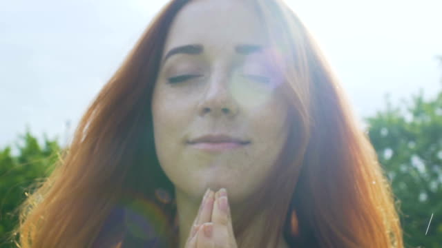 Praying-in-rain-red-haired-woman-with-freckles-feels-God-existence-peace-of-mind