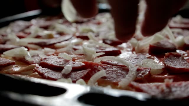 Bow-falls-on-top-of-the-pizza-salami-The-concept-of-pizza