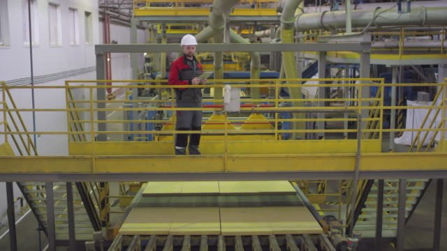 Male-Operator-Controlling-Finished-Product-at-Manufacturing-Plant