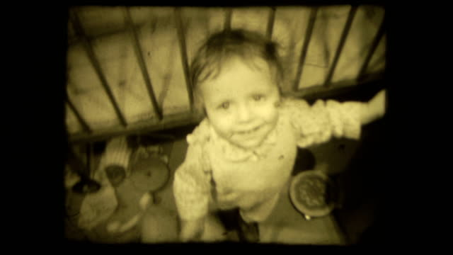 Baby-s-first-steps-Concept-family-loving-relationship-Vintage-8-mm-film-screen-with-4-x-3-ratio