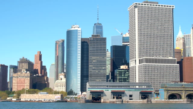 CLOSE-UP:-Staten-Island-Ferry-building-glassy-skyscrapers-in-Downtown-Manhattan