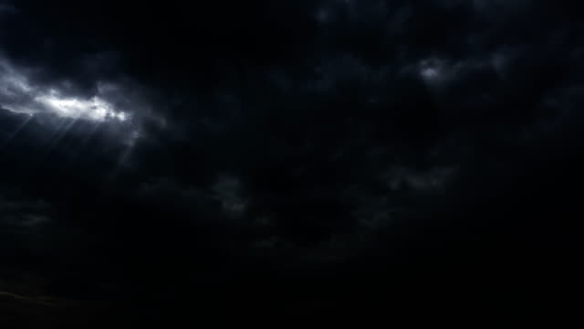 Thunderstorm-clouds-at-night-with-light-rays-from-top-4K-Timelapse-Loop-