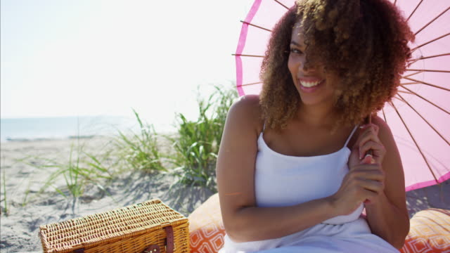 Portrait-of-African-American-female-on-grass-dunes