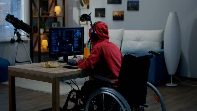 Disabled-boy-hacking-on-his-computer