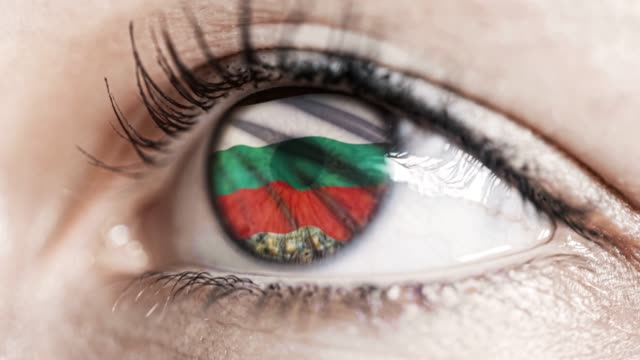 woman-green-eye-in-close-up-with-the-flag-of-bulgaria-in-iris-with-wind-motion-video-concept