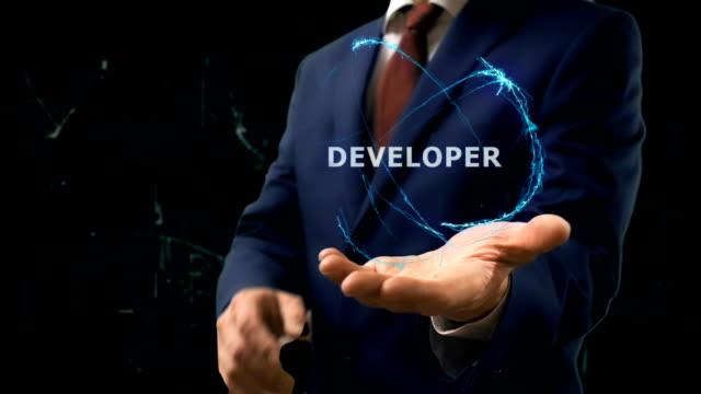 Businessman-shows-concept-hologram-Developer-on-his-hand