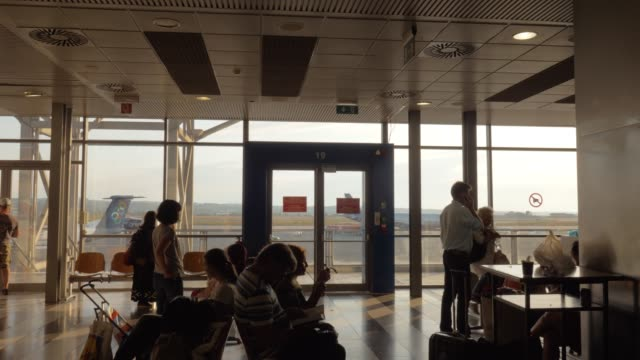 People-in-the-waiting-room-of-airport-in-Thessaloniki-Greece