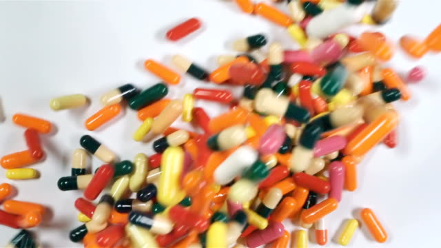 A-lot-of-colored-pills-or-drugs-background-Many-medication-on-the-table-First-aid-kit-with-pills-Pharmacy-with-medicine-