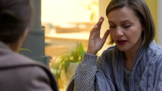 Woman-complaining-about-problems-to-close-friend-or-psychologist-closeup