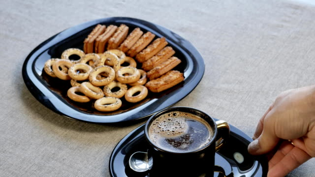 Put-a-cup-of-coffee-on-the-table-There-is-a-plate-with-homemade-cookies-on-the-table-