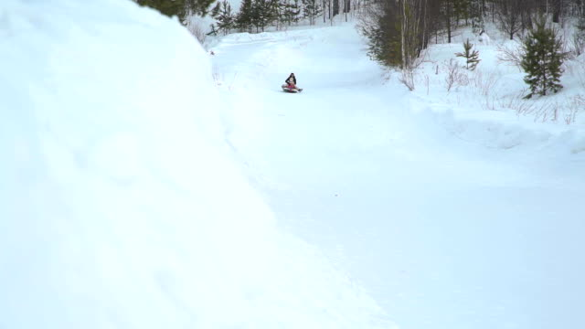 Girl-and-Woman-Riding-Fast-on-a-Sledding-Tubing