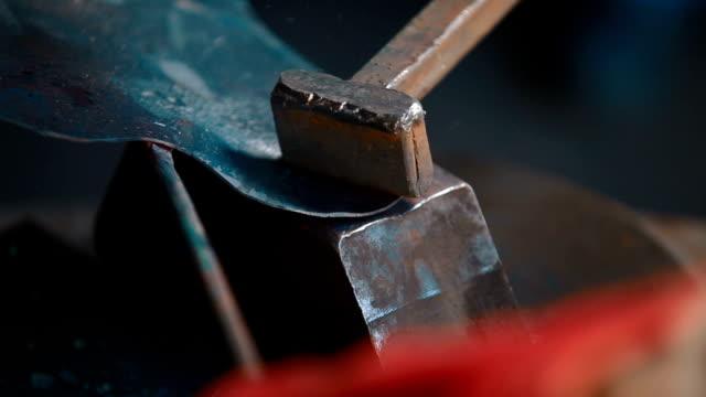 Red-hot-iron-lingot-on-a-press-machine