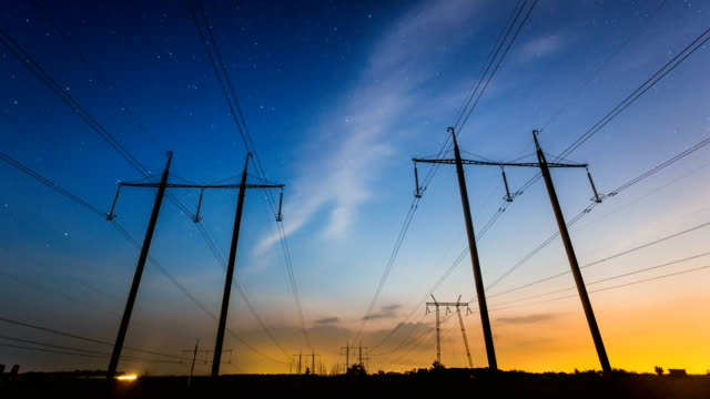Day-to-night-time-lapse-of-high-voltage-power-lines