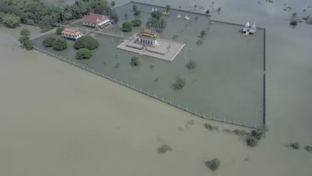 Aerial-view-:-fly-up-revealing-a-pagoda-is-surrounded-by-floodwaters