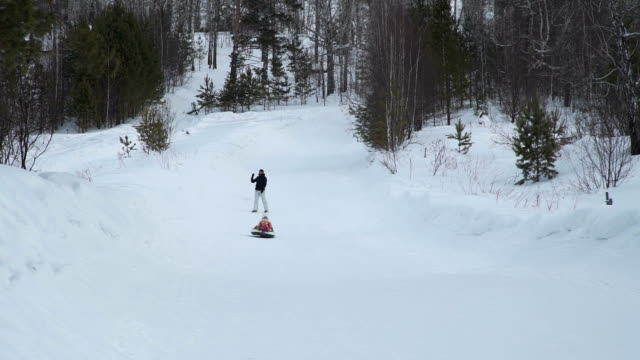 Little-Girl-Rides-on-a-Sledding-Tubing-from-Hill