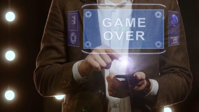 Businessman-shows-hologram-Game-Over