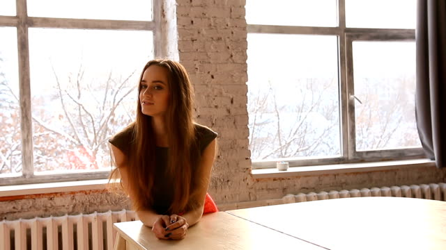 Attractive-young-woman-leaned-on-a-white-grand-piano