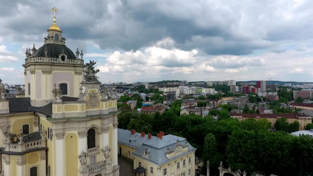 The-drone-flies-by-St-George-s-Cathedral-in-Lviv-and-shooting-city-under-clouds