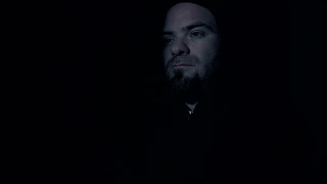 close-up-on-Sad-and-thoughtful-man-with-hood-in-the-dark