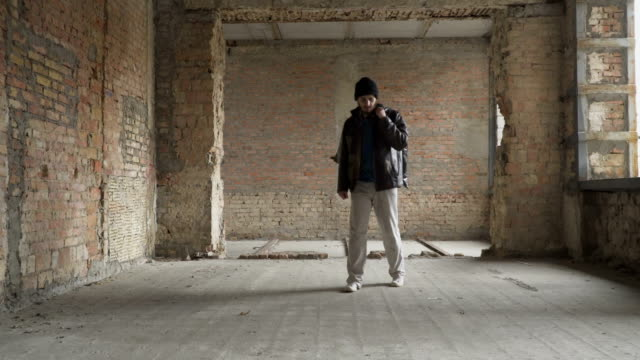 Sick-vagrant-searches-food-clothes-in-abandoned-building