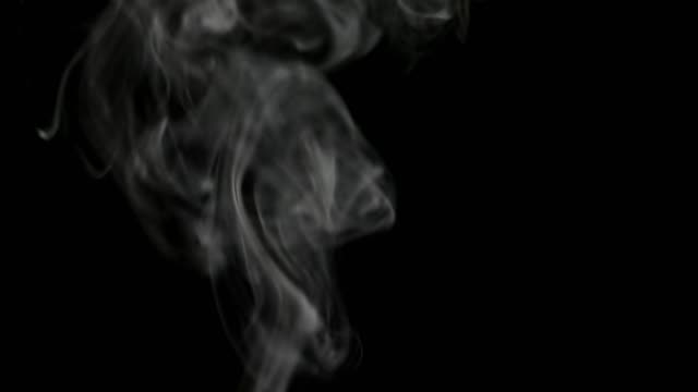 Realistic-white-steam-on-black-isolated-background-Great-for-overlay-in-a-video-editor