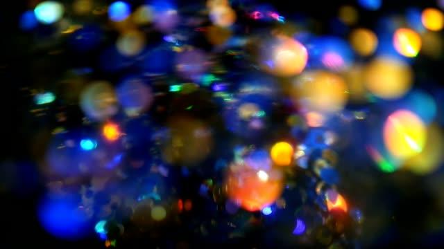 Defocused-shimmering-multicolored-glitter-confetti-black-background-Holiday-abstract-festive-bokeh-light-spots-