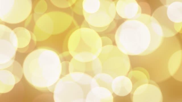 lazo-de-bokeh-de-fondo-abstracto-con-animados-brillantes-oro