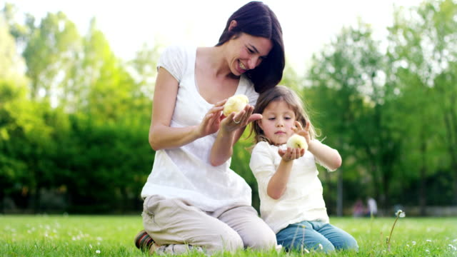 The-best-moments-from-life-the-sweet-girls-plays-in-the-park-with-little-chickens(yellow)-on-the-background-of-green-grass-and-trees-the-concept:-children-love-ecology-environment-youth-