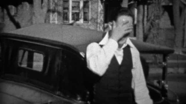1933:-Suave-man-wearing-white-collared-shirt-gets-embarrassed-