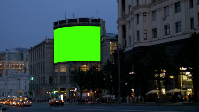 A-large-billboard-on-an-ancient-building-on-a-busy-street-Green-screen-