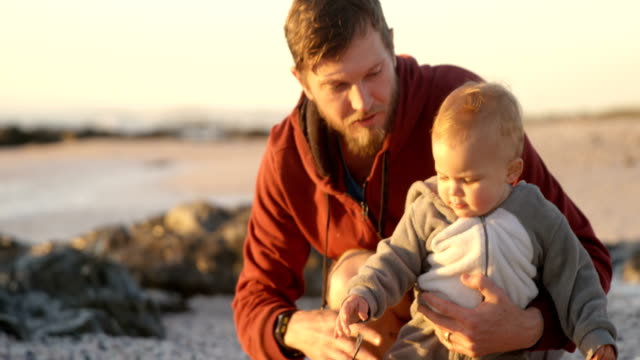 Father-and-baby-boy-playing-with-their-dog-4k