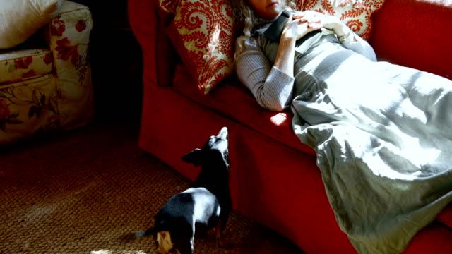 Mature-woman-sleeping-in-living-room-4k