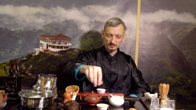 Master-man-holding-a-tea-ceremony-Eastern-traditions