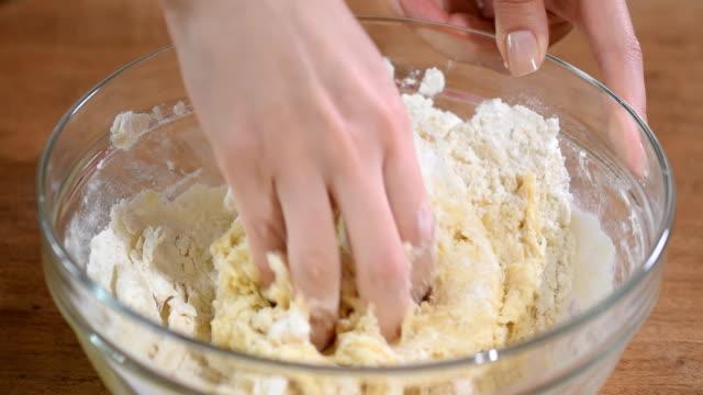 Woman-kneading-dough-close-up-