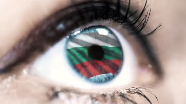 woman-blue-eye-in-close-up-with-the-flag-of-Bulgaria-in-iris-with-wind-motion-video-concept
