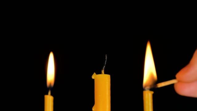 Burning-Candle-With-Black-Background-