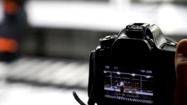 Camera-taking-photo-of-engineer-caring-boxes-at-work