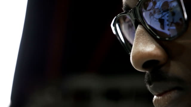 Man-face-in-glasses-close-up