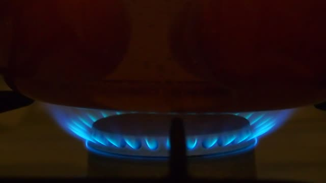 Fire-burning-under-saucepan-with-boiling-eggs